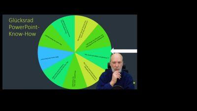 Screenshot Folie Glücksrad und Vortragender